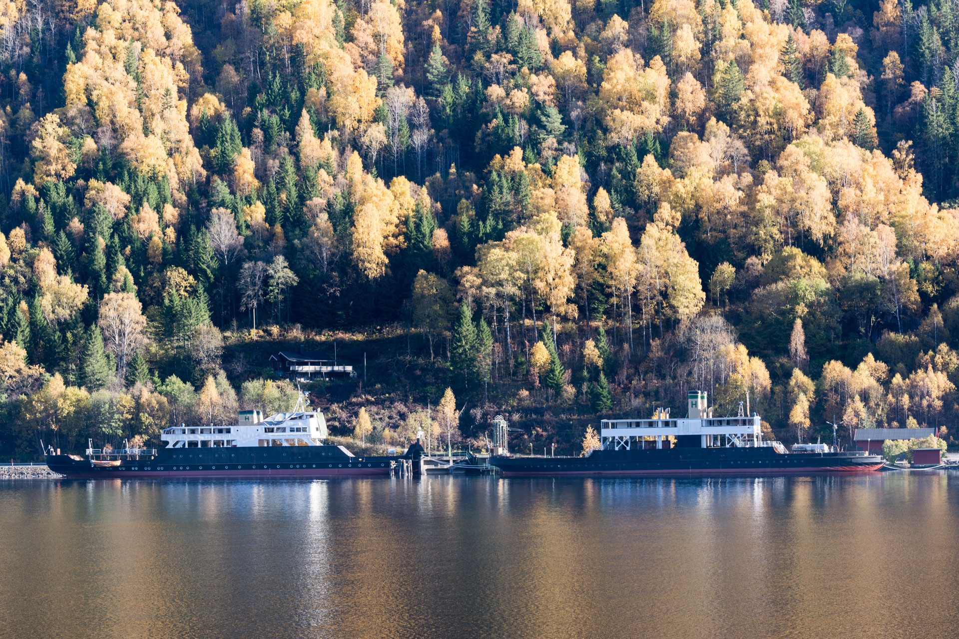 """Storegut and Ammonia. The ferries M/F """"Storegut"""" and D/F """"Ammonia """" are part of the transport system around Rjukan and Notodden which consists of the Tinnos Line ferries on Lake Tinnsjøen and the Rjukan Line. Photo: Per Berntsen, the Directorate for Cultural Heritage"""