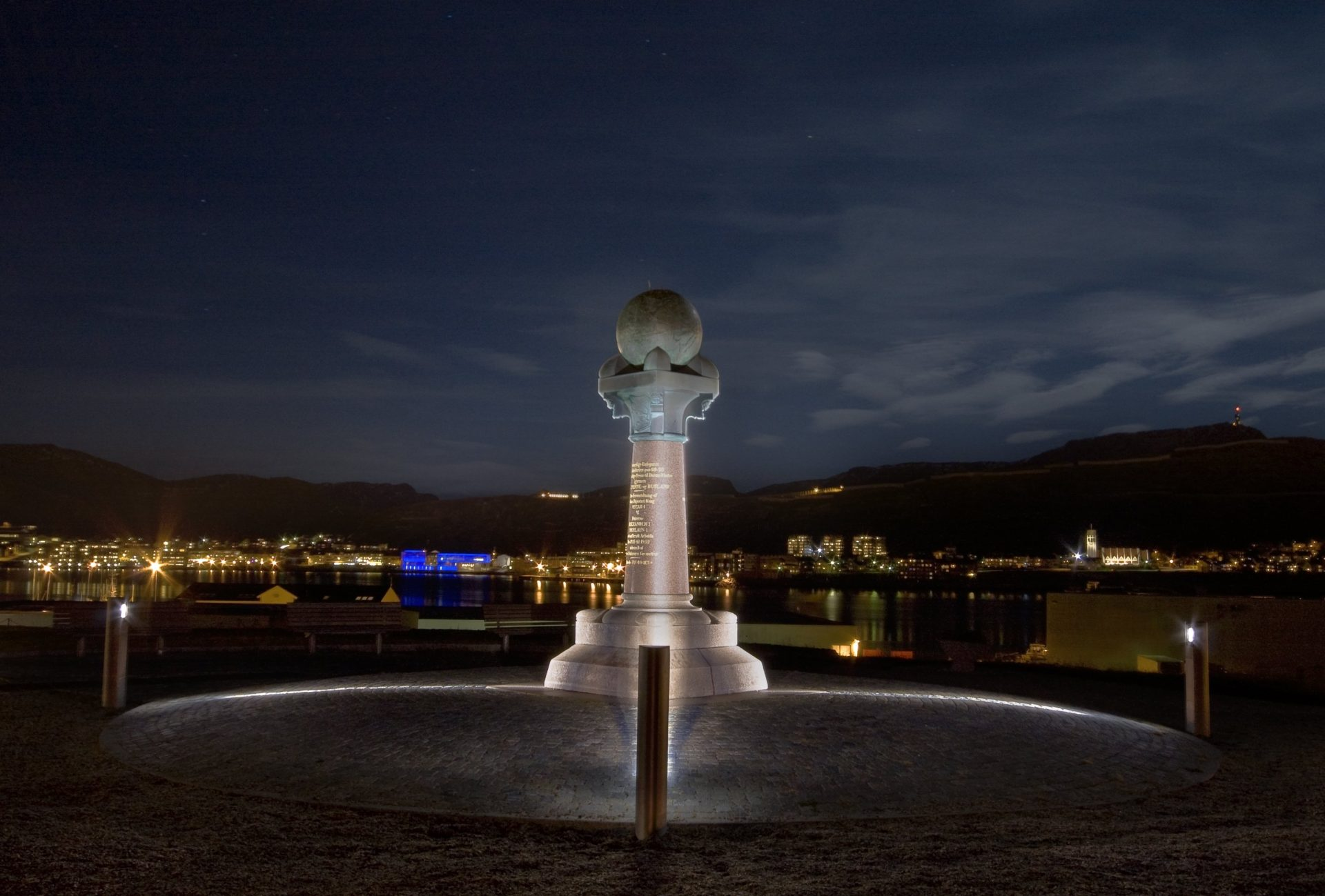 Photo of the Struve Geodetic Arc at night. The monument in Hammerfest marks the northernmost mainland point on the Struve Geodetic Arc. Photo: Zenisk