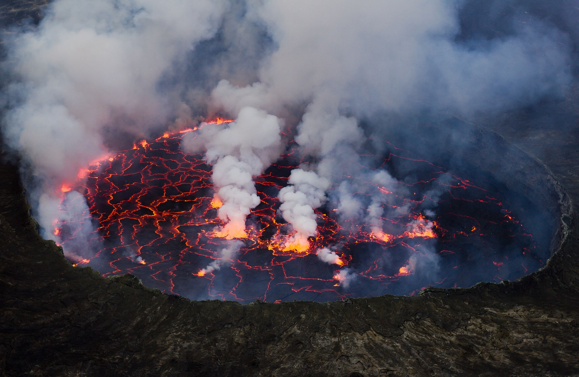 Photo of the Virunga National Park World Heritage site. Virunga national park in the Democratic Republic of the Congo has no less than seven volcanoes, two of which are the most active in Africa. The Nyiragongo volcano features a liquid, alkaline lava lake that fills its entire crater. The volcano's periodic eruptions have catastrophic consequences for the surrounding areas. Photo: Cai Tjeenk Willink (CC BY-SA.3.0) via Wikimedia Commons